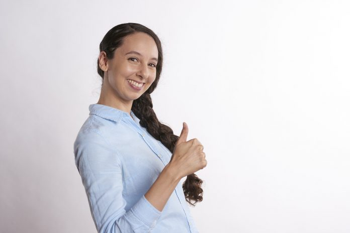 Female Brunette holding up a thumb